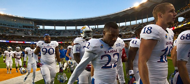 Kansas cornerback Greg Allen (22) leaves the field with his teammates after a 60-14 ripping by Baylor on Saturday, Nov. 1, 2014 in Waco, Texas.