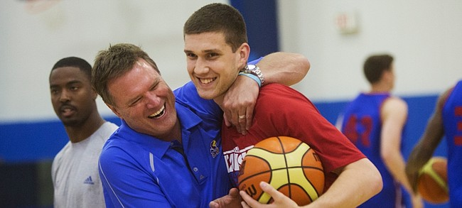 KU coach Bill Self, left, jokes with Svi Mykhailiuk as Self said he hadn't seen Svi for a while, just before camp on Tuesday, June 9, 2015.