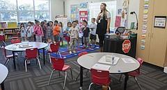 Students recite the Pledge of Allegiance in an updated kindergarten classroom at Hillcrest Elementary School.