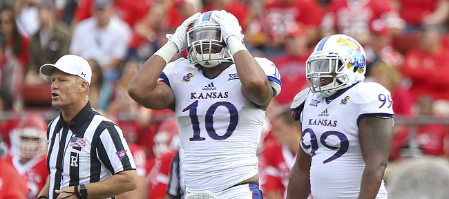 Kansas defensive end Ben Goodman (10) and defensive tackle Corey King lament a penalty called against Goodman after he dragged Rutgers quarterback Chris Laviano (5) down by the collar during the second quarter on Saturday, Sept. 26, 2015 at High Point Solutions Stadium in Piscataway, New Jersey.