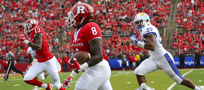 Kansas linebacker Cameron Rosser (59) chases Rutgers running back Josh Hicks (8), who heads up the sideline for a long gain to set up a touchdown for the Scarlet Knights during the second quarter on Saturday, Sept. 26, 2015 at High Point Solutions Stadium in Piscataway, New Jersey.