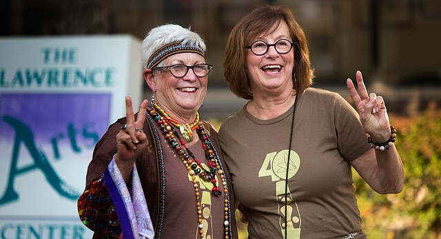Deanell Tacha, left, and Ann Evans, right, celebrate the Lawrence Arts Center's 40th anniversary at a 70s-themed block party, Friday, Sept. 25, 2015, at 940 New Hampshire.
