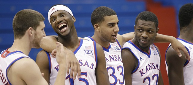 Standing from left, KU basketball players Sviatoslav Mykhailiuk, Carlton Bragg Jr., Landen Lucas and Dwight Coleby, wait for a team photograph Thursday, Oct. 1, 2015, during the men's basketball media day.