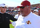 Kansas head coach David Beaty congratulates Iowa State offensive coordinator and former KU head coach Mark Mangino following the Cyclones' 38-13 win over the Jayhawks on Saturday, Oct. 3, 2015 at Jack Trice Stadium in Ames, Iowa.