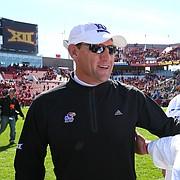 Kansas head coach David Beaty congratulates Iowa State offensive coordinator and former KU head coach Mark Mangino following the Cyclones' 38-13 win over the Jayhawks on Saturday, Oct. 3, 2015 at Jack Trice Stadium in Ames, Iowa.
