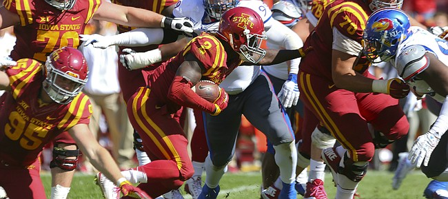 Iowa State running back Mike Warren (2) has some blockers as he runs into the Kansas defense deep in the Jayhawks' territory during the fourth quarter on Saturday, Oct. 3, 2015 at Jack Trice Stadium in Ames, Iowa.