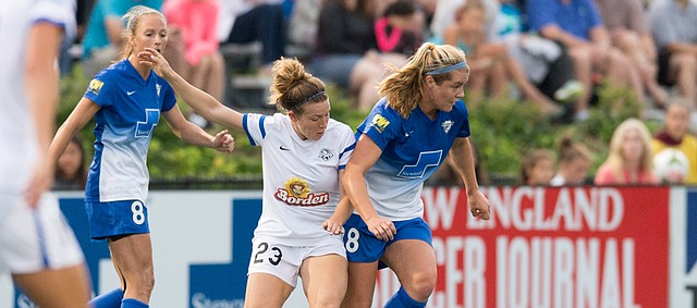 FC Kansas City's Caroline Kastor (23) makes a move against the Boston Breakers in this photo from July 9 in Allston, Massachusetts. Kastor played at Kansas University, sat out a year, then joined the Blues this season — just in time to win the National Women's Soccer League championship.