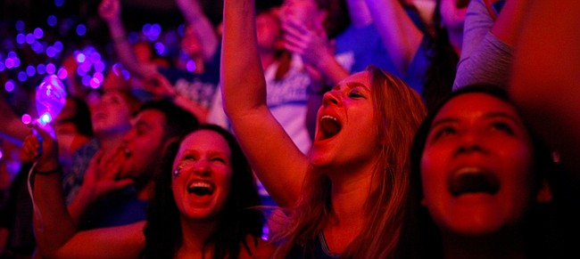 Kansas University sophomore, Sydnie Kelly, Lee Summit, Mo., right of center, goes wild with other Jayhawk fans as the men's basketball team is introduced during Late Night in the Phog on Friday, Oct. 10, 2014 at Allen Fieldhouse.