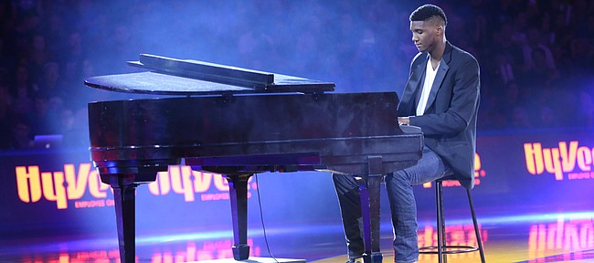 Kansas freshman forward Carlton Bragg performs before the fieldhouse crowd during Late Night in the Phog, Friday, Oct. 9, 2015 at Allen Fieldhouse.