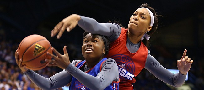 Blue Team guard Jayde Christopher is fouled by Red team center Caelynn Manning Allen during Late Night in the Phog, Friday, Oct. 9, 2015 at Allen Fieldhouse.