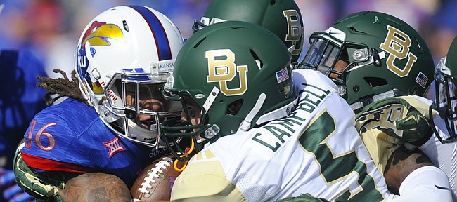Kansas running back Taylor Cox (36) is stopped by Baylor linebacker Grant Campbell (5) and several other Bears during a run in the first quarter on Saturday, Oct. 10, 2015 at Memorial Stadium.