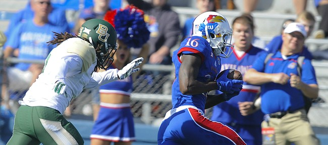Kansas wide receiver Steven Sims Jr. (16) runs in the Jayhawks' lone touchdown past Baylor cornerback Tion Wright (3) during the first quarter on Saturday, Oct. 10, 2015 at Memorial Stadium.