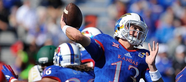Kansas quarterback Ryan Willis (13) throws during the first quarter on Saturday, Oct. 10, 2015 at Memorial Stadium.