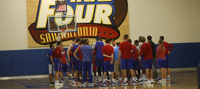 Kansas University coach Bill Self and the Jayhawks gather before practice on Thursday, Oct. 15, 2015, at the KU practice facility.
