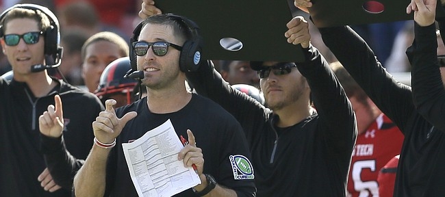 Texas Tech head coach Kliff Kingsbury calls a play from the sidelines during the first half of an NCAA college football game against TCU Saturday, Sept. 26, 2015, in Lubbock, Texas. (AP Photo/LM Otero)