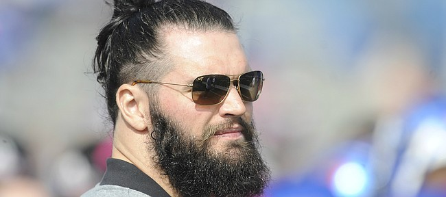 Former Kansas linebacker Ben Heeney, who now plays for the Oakland Raiders, watches from the sideline during the third quarter on Saturday, Oct. 17, 2015 at Memorial Stadium.