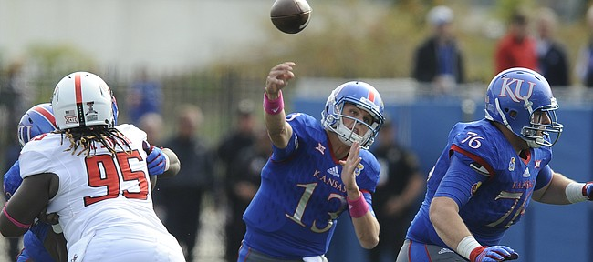 Kansas quarterback Ryan Willis (13) throws between blockers during the third quarter on Saturday, Oct. 17, 2015 at Memorial Stadium.