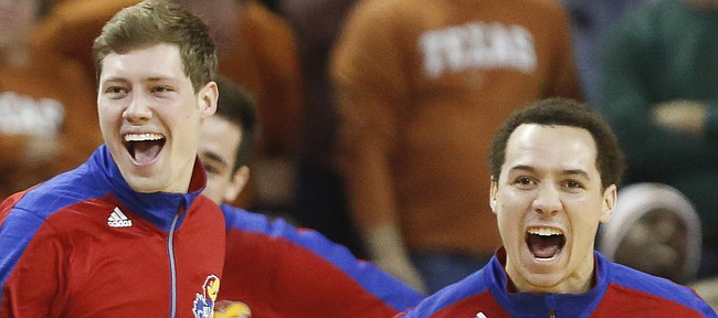 Kansas players Tyler Self, left, and Evan Manning go wild during a timeout in the second half on Saturday, Jan. 24, 2015 at Frank Erwin Center in Austin, Texas.