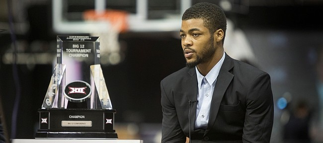KU junior Frank Mason sits next to the Big 12 Trophy as he was being interview during   Big 12 Media Day Tuesday Oct. 20, 2015 at the Sprint Center.