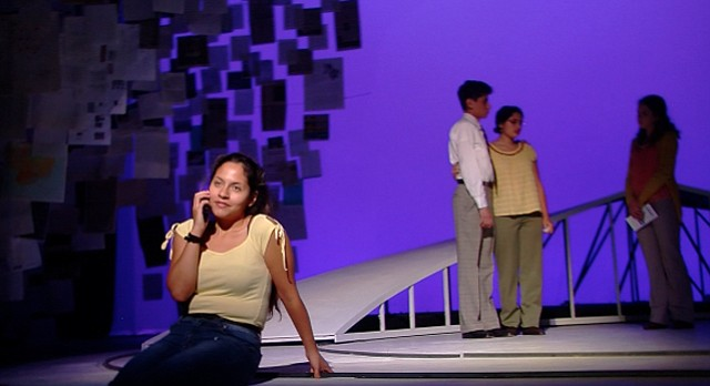 "Kansas University junior Alejandra Villasante Ramos, seen in the foreground of this photo, plays Johanna Orozco, the Cleveland teenager who was sexually assaulted and shot in the face by her abusive ex-boyfriend in 2007, in KU Theatre's production of ""Johanna: Facing Forward."" The play ends its run at KU on Sunday."