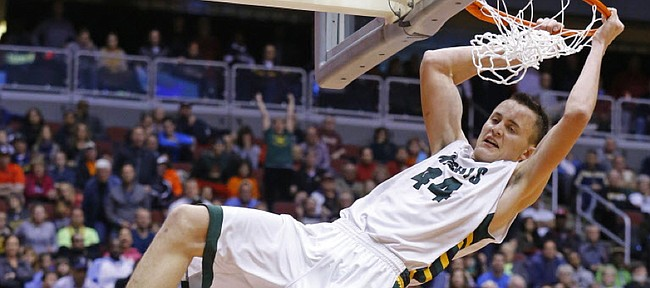 Gilbert Christian High's Mitch Lightfoot slams against Arcadia in the Div. II basketball championship game on March 2, 2015, in Glendale, Ariz. Lightfoot committed to Kansas University on Saturday.