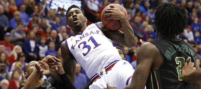 Kansas forward Jamari Traylor (31) is fouled as he comes down with an offensive rebound over Baylor guard Lester Medford (11) during the first half, Saturday, Feb. 14, 2015 at Allen Fieldhouse.