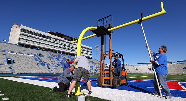 Workers repair the south goal posts at Kansas University's Memorial Stadium on Monday, Nov. 2, 2015. KU Public Safety said nearly $10,000 in damage was done to the goal posts and a stadium gate after the Royals won the World Series Sunday night.