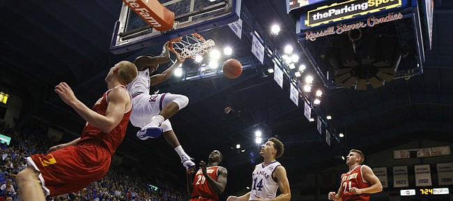Kansas forward Carlton Bragg Jr. (15) delivers on a dunk during the first half on Wednesday, Nov. 4, 2015 at Allen Fieldhouse.