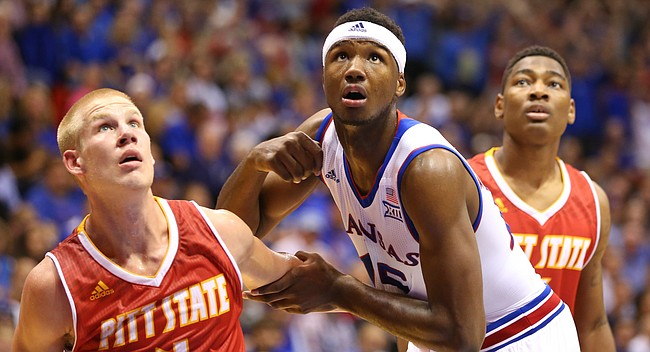 Kansas forward Carlton Bragg Jr. (15) battles for position with Pittsburg State guard Josiah Gustafson (4) and guard Chris Owens (5) during the first half on Wednesday, Nov. 4, 2015 at Allen Fieldhouse.