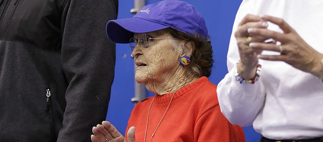 Ninety-eight-year-old Jayhawk fan Margaret Shirk stands up to applaud during the first half on Wednesday, Nov. 4, 2015 at Allen Fieldhouse.