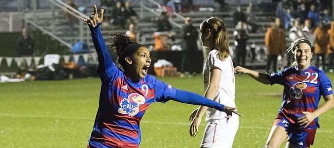 Kansas senior Ashley Williams (9) and freshman Parker Roberts (22) celebrate Williams' first half goal against Texas during their Big 12 tournament soccer match at Swope Park Soccer Village in Kansas City, Mo. on Wednesday night.