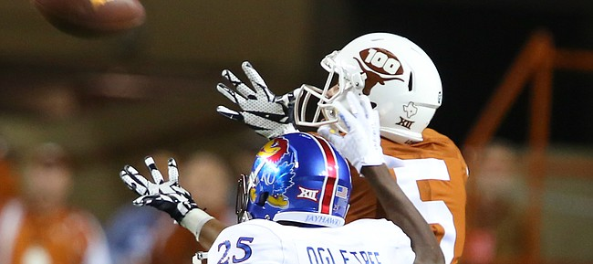 Texas wide receiver Lorenzo Joe (5) catches a deep pass beyond Kansas cornerback Marnez Ogletree (25) during the first quarter on Saturday, Nov. 7, 2015 at Darrell K. Royal Stadium in Austin, Texas.
