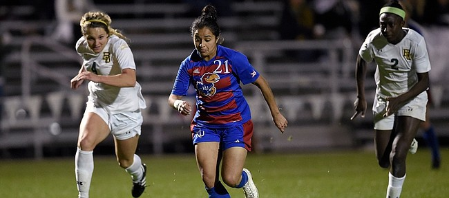 Kansas University midfielder Liana Salazar (21) breaks away for a goal in the second half of the Jayhawks' 2-0 win over Baylor on Friday in the semifinals of the Big 12 soccer tournament. Kansas and Texas Tech will play in the final at 3 p.m. this afternoon at Swope Soccer Village in Kansas City, Missouri.