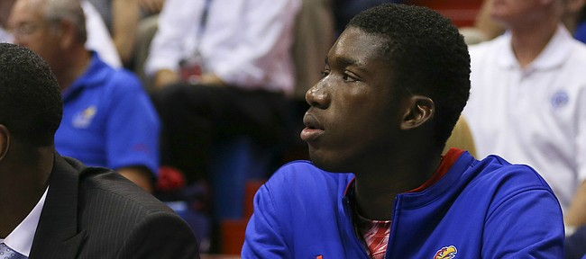 Kansas forward Cheick Diallo watches from the bench during the second half on Wednesday, Nov. 4, 2015 at Allen Fieldhouse. Diallo has yet to be cleared the NCAA.