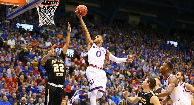 Kansas guard Frank Mason III (0) glides toward the bucket against Fort Hays State guard Kenny Enoch (22) during the first half, Tuesday, Nov. 10, 2015 at Allen Fieldhouse.