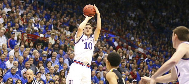 Kansas guard Sviatoslav Mykhailiuk (10) pulls up for a three over Fort Hays State guard Aaron Nicholson (1)  during the second half, Tuesday, Nov. 10, 2015 at Allen Fieldhouse.