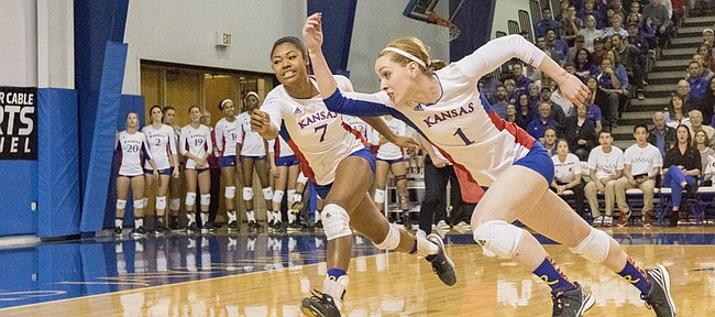 Kansas' Anna Church (1) and Tiana Dockery (7) try to chase down the ball during their volleyball match against Texas Wednesday evening at the Horejsi Center. The Jayhawks fell to the Longhorns in five sets. Kansas only has two losses on the season with both coming at the hands of Texas.
