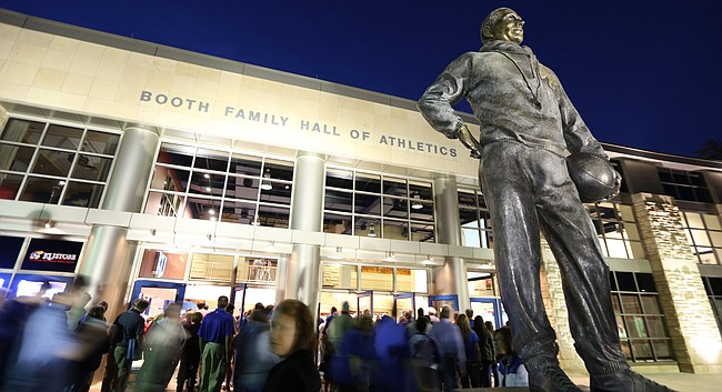 Fans file through the doors past the statue of Phog Allen for the 60th Anniversary celebration of Allen Fieldhouse on Monday, Oct. 27, 2014.