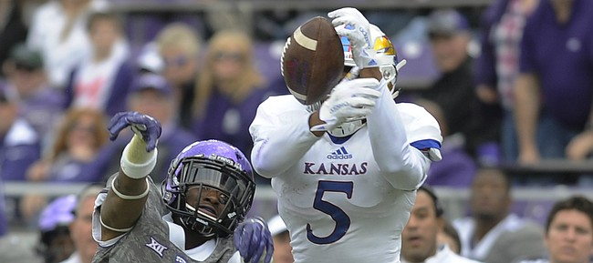 Kansas sophomore Bobby Hartzog (5) gets his hands on a pass in front of TCU's Torrance Mosley (2) on Nov. 14, 2015, at Fort Worth, Texas.