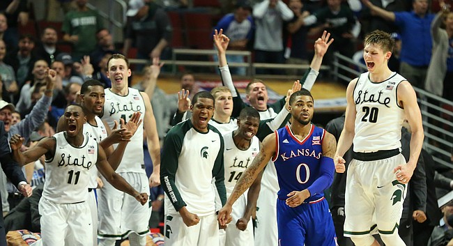 The Michigan State bench goes crazy after Michigan State guard Matt McQuaid (20) hit a late three-pointer over Kansas guard Frank Mason III (0) during the second half, Tuesday, Nov. 17, 2015 at United Center in Chicago.
