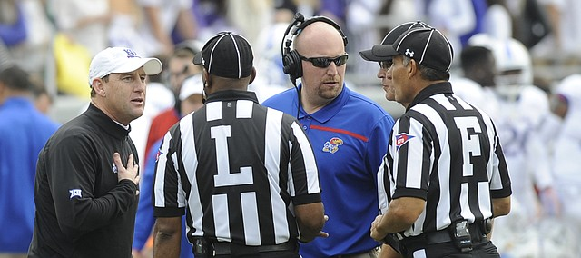 KU coach David Beaty, left, pleads his case to officials in the Jayhawks' 23-17 loss to TCU on Saturday, Nov. 14, 2015, in Fort Worth, Texas.