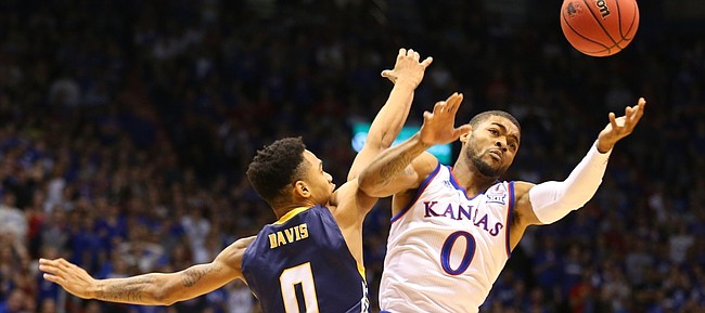 Kansas University junior guard Frank Mason III leaps for a loose ball in the opening minutes of the Jayhawks' season opener against Northern Colorado, on Nov. 13, 2015, at Allen Fieldhouse.