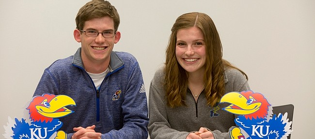From left, FSHS Cross Country runners Ethan Donley and Claire Sanner both signed letters of intent to KU on Tuesday November 17, 2015.