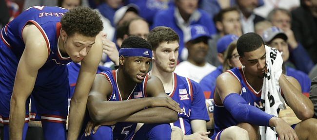 Kansas players Brannen Greene, left, Carlton Bragg Jr., Sviatoslav Mykhailiuk and Landen Lucas watch from the bench as Michigan State widens its lead late in the second half, Tuesday, Nov. 17, 2015 at United Center in Chicago.