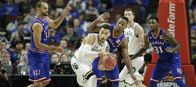 Kansas players Perry Ellis, left, and Wayne Selden hound Michigan State guard Denzel Valentine during the first half, Tuesday, Nov. 17, 2015 at United Center in Chicago.