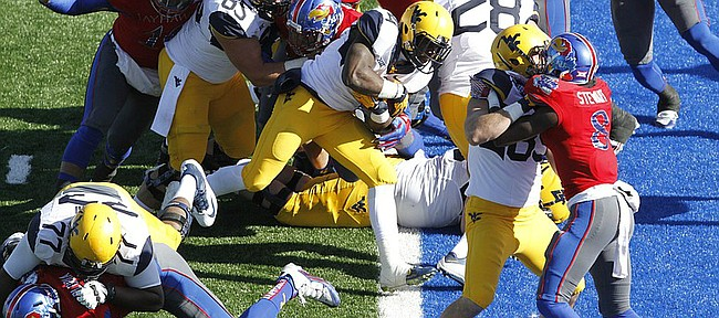 West Virginia running back Wendell Smallwood (4) center, scores a touchdown against Kansas in the Jayhawks 49-0 loss to the  Mountaineers Saturday, Nov. 21, 2015, at Memorial Stadium.
