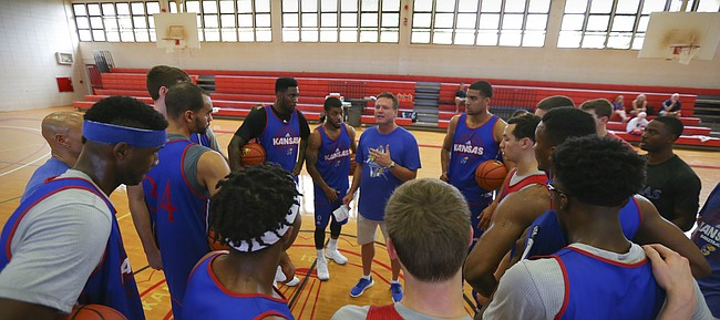 Members of Kansas men's basketball team huddle around head coach Bill Self as he gives a talk prior to a practice, Saturday, Nov. 21, 2015 at Lahainaluna High School in Lahaina, Maui. Freshman Cheick Diallo did not practice as he has yet to be cleared to participate in team practices on the road by the NCAA.
