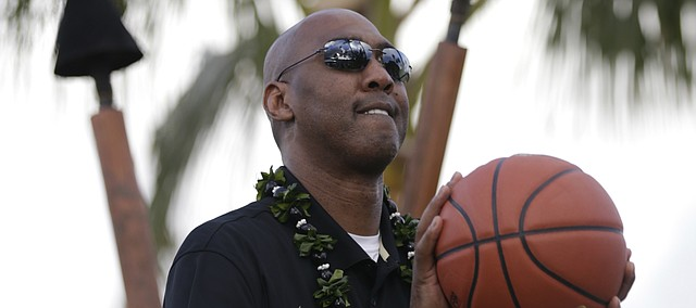 Former Kansas assistant, player and current Wake Forest head coach Danny Manning takes a shot during a free throw challenge following a press conference with the Maui Invitational coaches on Sunday, Nov. 22, 2015 outside the Sheraton Maui.
