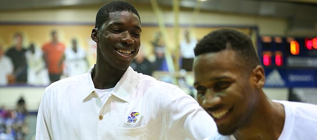 Kansas forward Cheick Diallo gives a playful shove to teammate Wayne Selden Jr. before tipoff on Monday, Nov. 23, 2015 at Lahaina Civic Center in Lahaina, Hawaii.