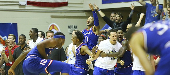 The Kansas bench goes wild after another bucket by Kansas guard Sviatoslav Mykhailiuk during the second half, Monday, Nov. 23, 2015 at Lahaina Civic Center in Lahaina, Hawaii.